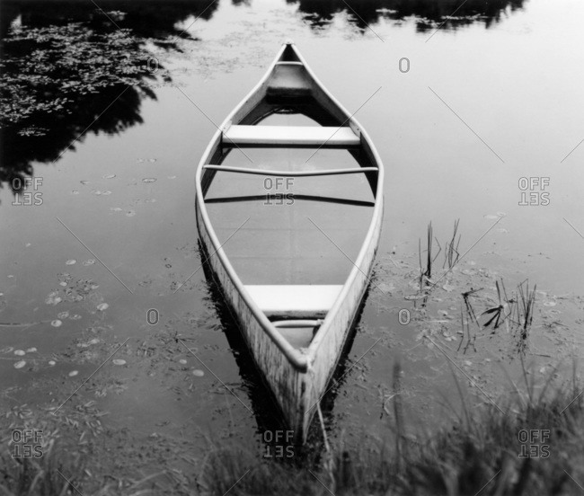 Old canoe with full of water