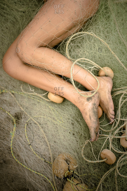 Girl's Bare Legs Lying Down on Hay Bales