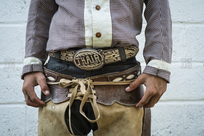 Rustic Cowboy wearing Western Chaps and Belt