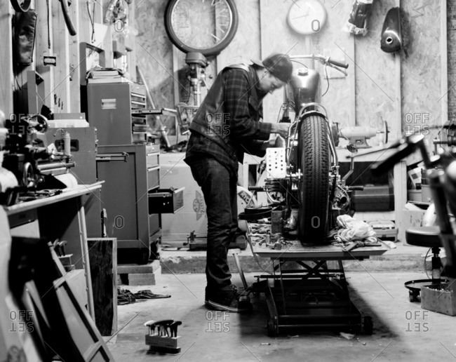 Man working on fixing a motorcycle