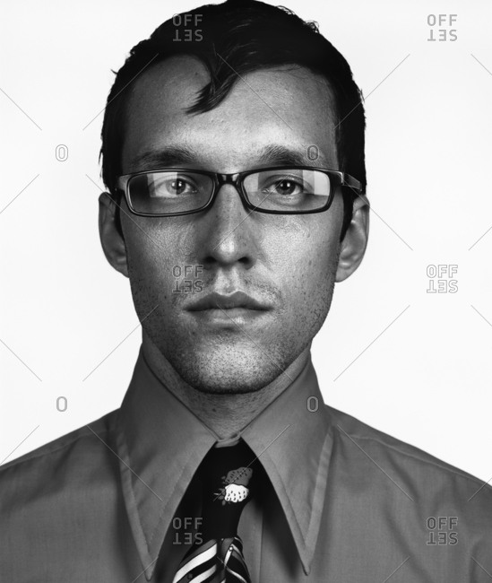 Portrait Of Smartly Dressed Man In Glasses
