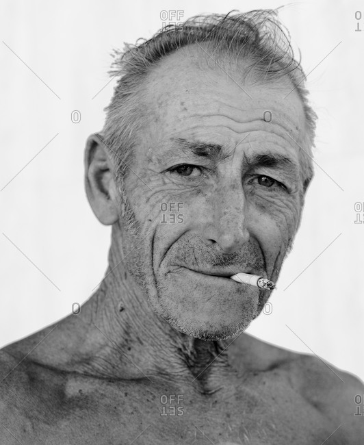 An old man smoking