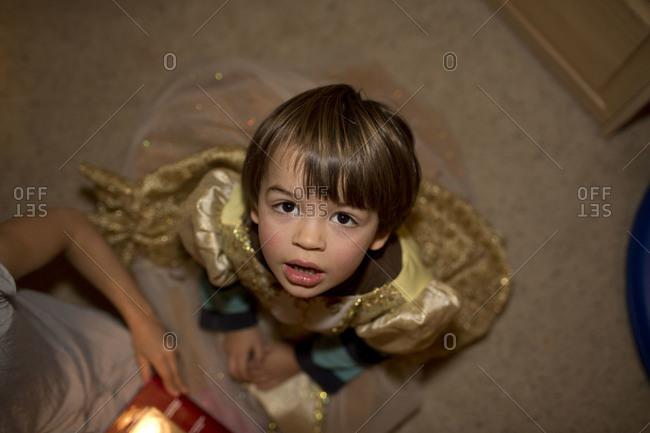 Overhead view of little child wearing princess dress.