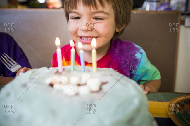 Cute little boy with his birthday cake.