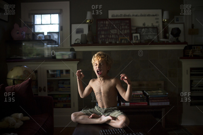 Little boy performing yogic meditation in the Padmasana posture.