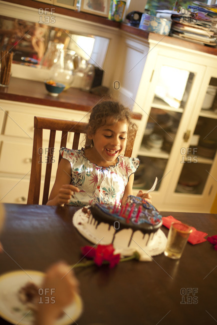Cute little girl with her birthday cake.