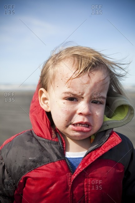 Portrait of toddler with sadness on his face.