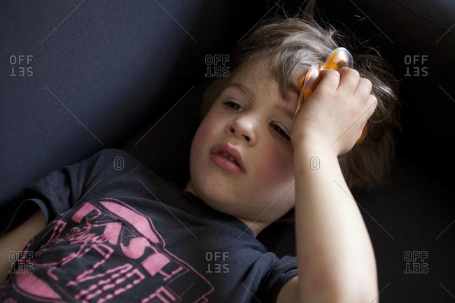 Little boy lying on a sofa