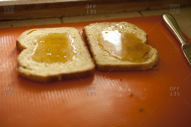 Two slices of bread with honey.
