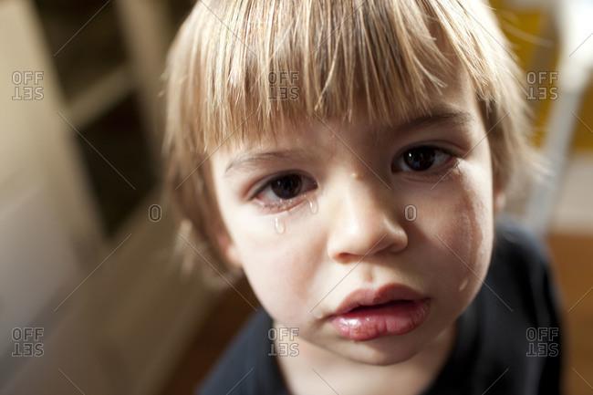Close-up portrait of sad little boy.