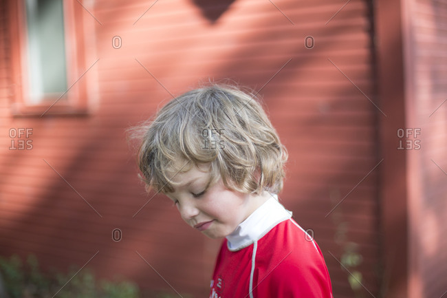 Portrait of young Caucasian boy walking outdoors