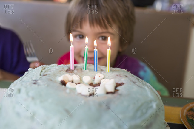 Portrait of young boy with birthday cake
