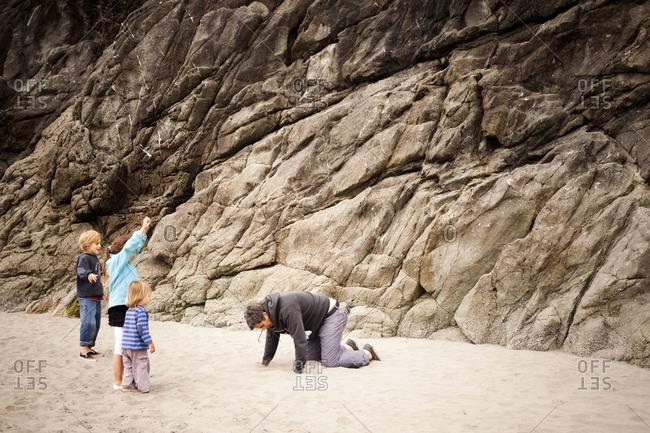 Children playing on sea coast