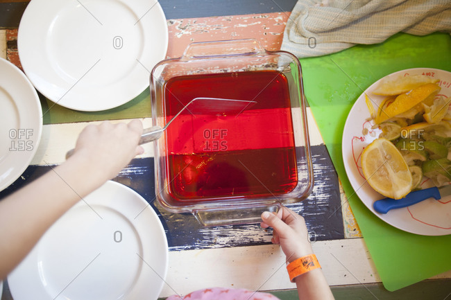Top view of young girl helping to prepare gelatin