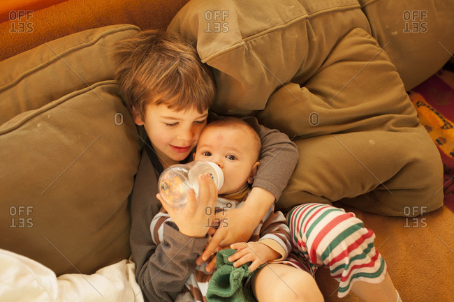 Top view of child feeding his little brother