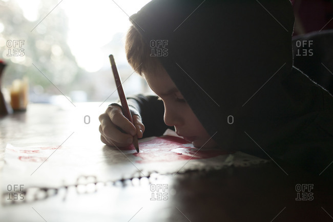 Closeup of child drawing on table