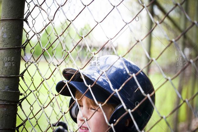 Portrait of boy in baseball helmet