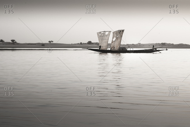 Boat with Sails on the water