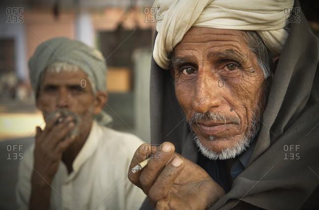 Two old Indian men smoking