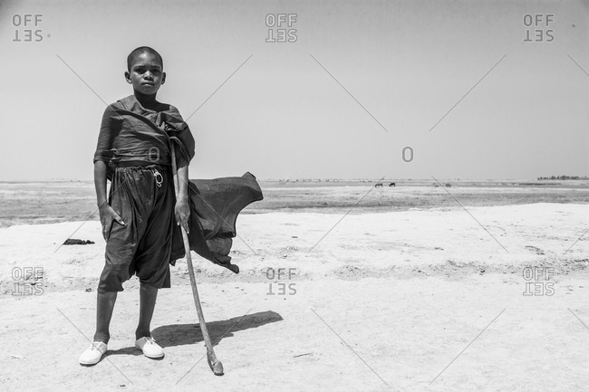 African boy with cane