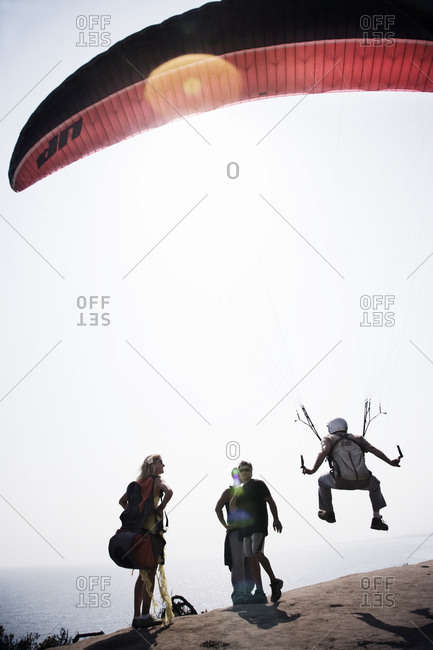 Group of people paragliding - Offset
