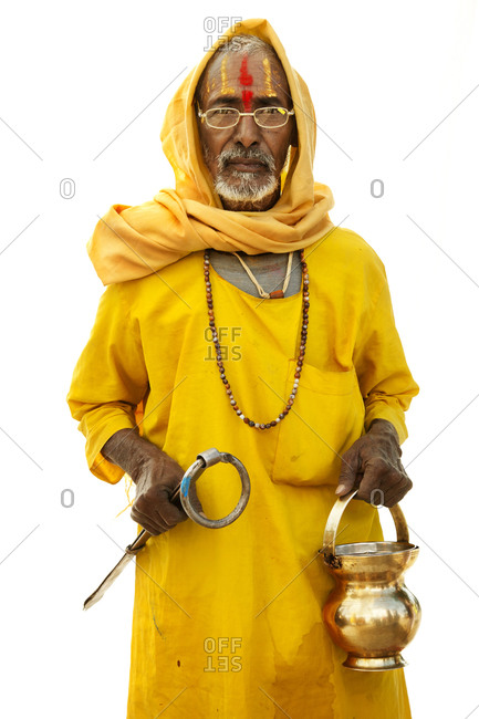 Indian man in yellow clothes with glasses