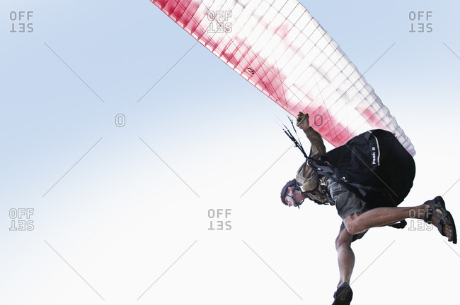 Person paragliding from the Offset Collection
