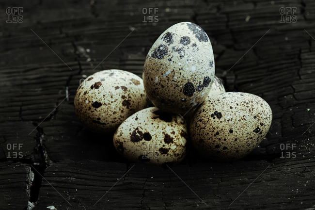 Five eggs in a pile lying on wood