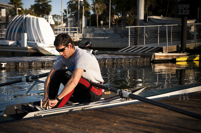Young  man preparing for sculling