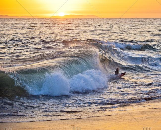 man surfing in dusk