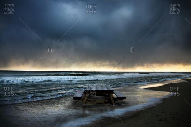 Picnic table in the shore break