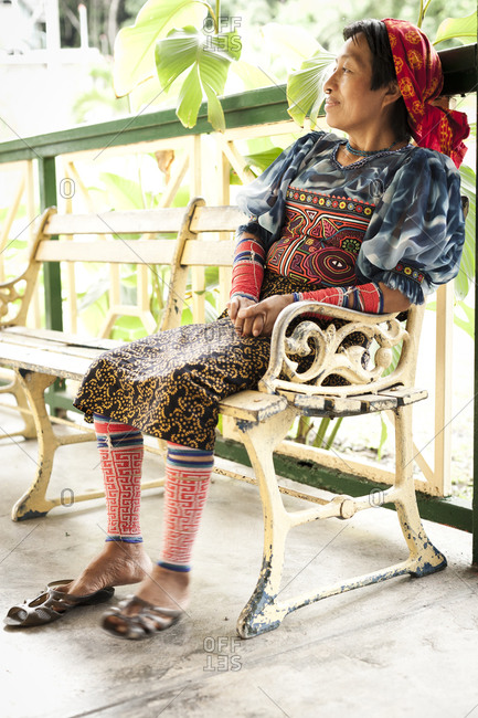 Kuna woman sitting on a bench in Panama, Colombia