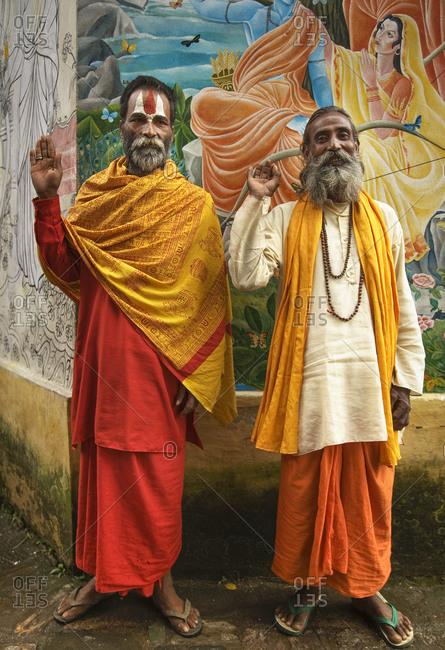 Friendly Hindu shadus waving