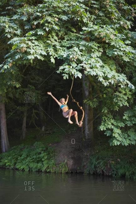 Teenage Girl Jumping Into Lake