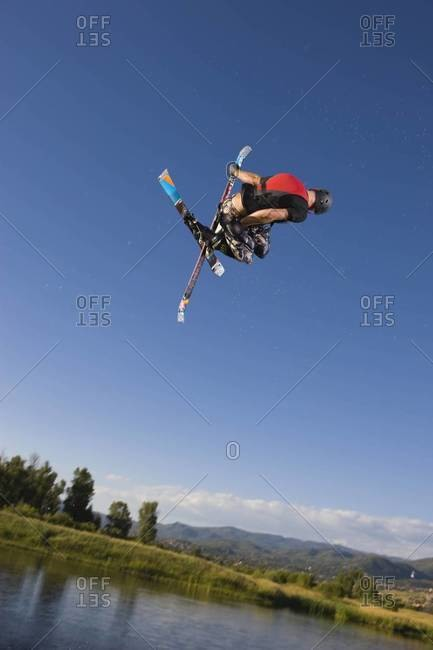 Ski jumper in twisting in the air
