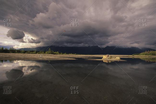 Red Floatplane And Thunderstorm Over The Knik River Near Palmer, Alaska