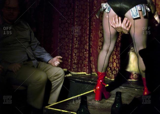 A Burlesque Dancer And Patron