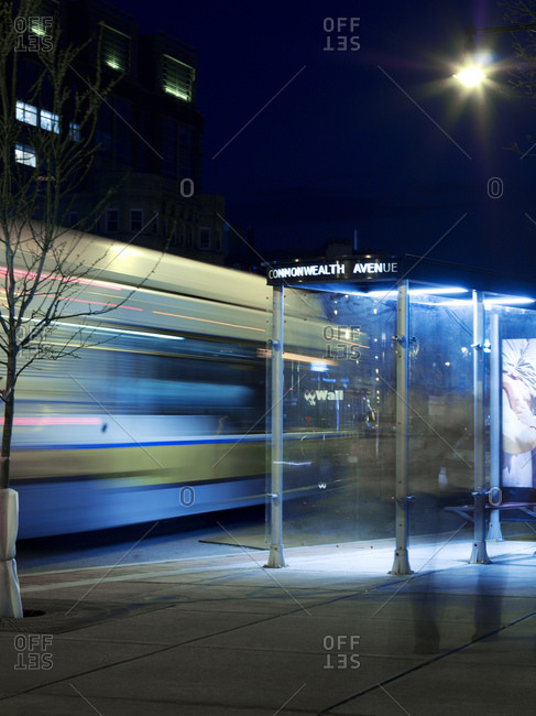 Motion Blur Of Bus Passing By Bus Stop