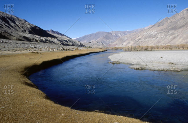 A River Winding Its Way Through The Hindu Kush Mountains