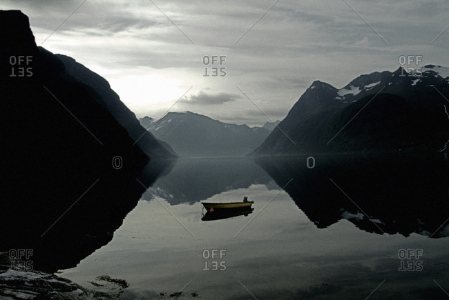 Boat in reflecting in the water of a norwegian lake