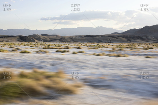 Desert Landscape Through Window Of Moving  Car