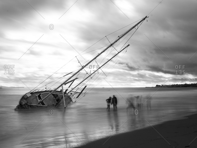 Seascape with wrecked sailboat at the beach of Santa Barbara, California