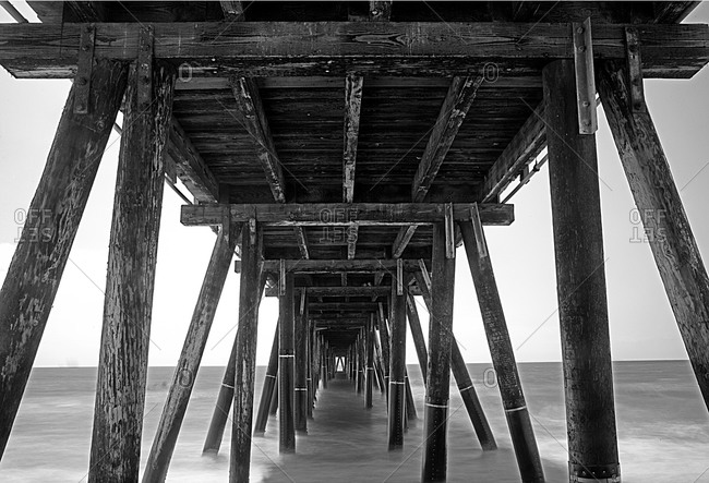 Black and white view under a pier