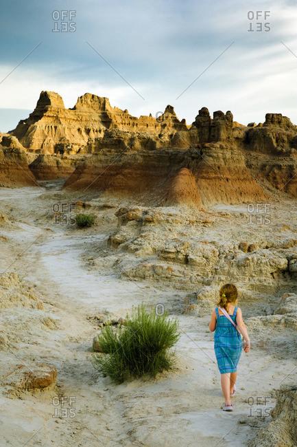 Girl Walking through Badlands, South Dakota, USA