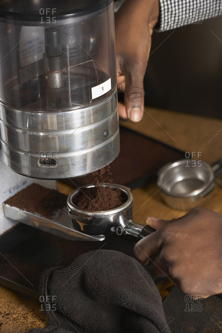 Grinding coffee for a shot of espresso