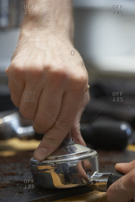 Tampering coffee prior to pulling a shot of espresso