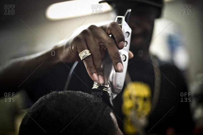 a man gives another man a haircut