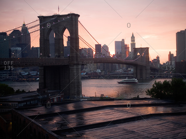 Span of Brooklyn Bridge at Sunset After Rain