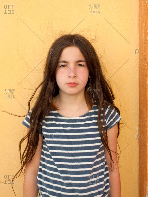 Young Girl with serious expression and frizzy hair