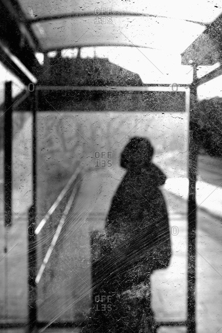 Man in bus shelter (B&W)